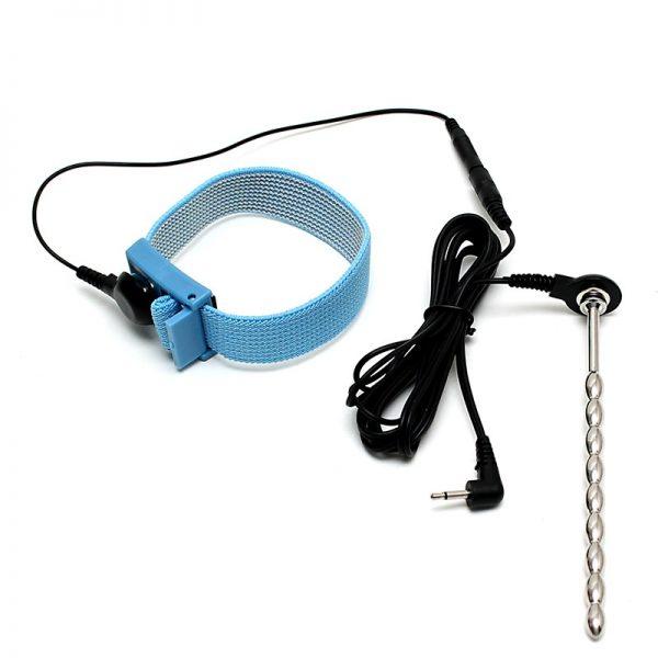 Rimba Electro Play set van elastische penisriem en metalen dilator beide met drukknoopaansluitingen. Beide accessoires moeten verbonden zijn met het lichaam. De riem om de penis of het scrotum en de urethra in de penis. Zodra de elektriciteit rondgaat